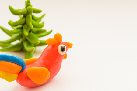Plasticine rooster cock on a white background.