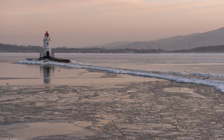 leading light: Lighthouse at sunset. Winter season.