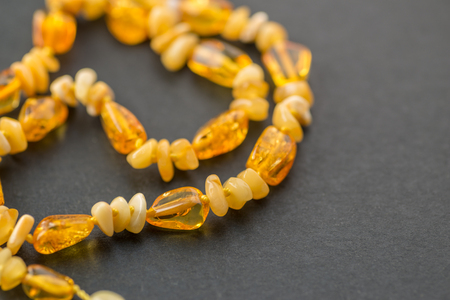 Amber necklace on dark background. Selective focus.