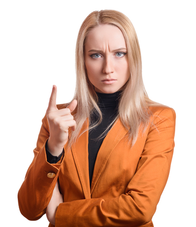 Frowning business woman pointing a finger upwards. Isolated on white.