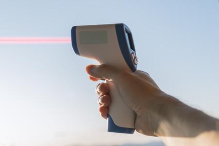 Laser rangefinder with laser beam. Reklamní fotografie