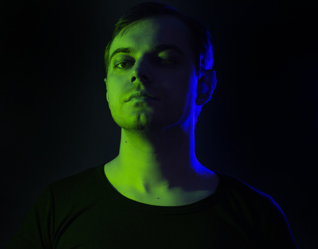 Portrait Of A Man With Colored Light And Dark Background Stock Photo Picture And Royalty Free Image Image 93777611