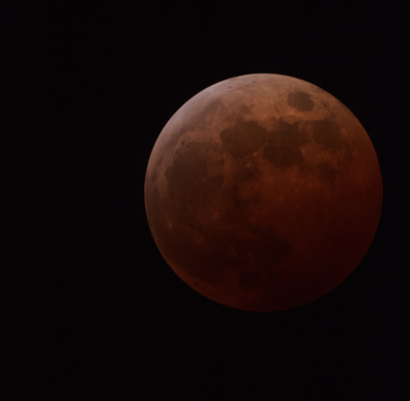 View of the Moon eclipse through telescope on October 8, 2014. High ISO shot. Stock Photo