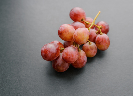 Grapes on dark background. Selective focus with shallow depth of field.