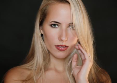 Portrait of beautiful sensual woman with green eyes. Studio shot. Stock Photo