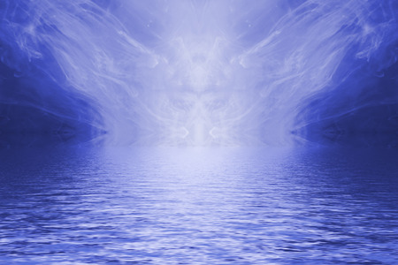 Blue ink forming patterns resembling Rorschach Test ink blots reflected in water.