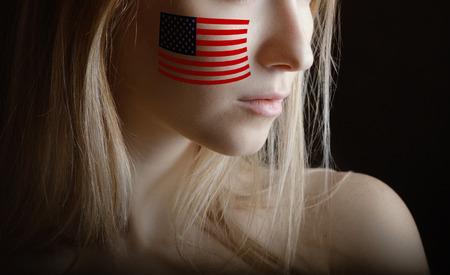 USA flag on womans cheek.