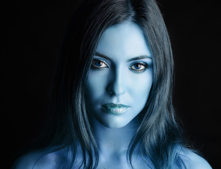 Portrait of a young woman model with blue make-up. Фото со стока