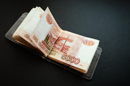 Five-thousandth banknotes in the wallet.