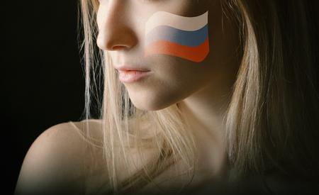Russia flag on womans cheek. Фото со стока