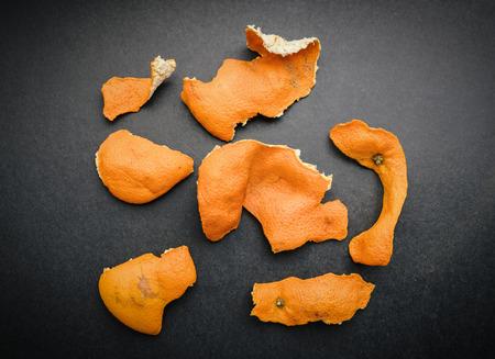 Dried mandarin peel on dark background. Фото со стока