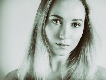 Portrait of a young woman - retro film effect.