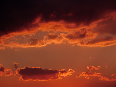 Dramatic sunset sky with orange clouds.