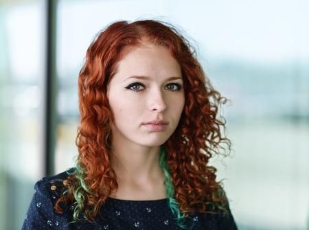 Portrait of a beautiful redhead girl. Фото со стока