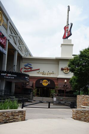 Houston, Texas - 24th April 2011 : The Hard Rock Cafe is located next to The Verizon Wireless Theater in the glittery theater district, a 35-foot replica of the Stevie Ray Vaughan Gibson Firebird guitar lights the way to the most rocking place in the city Stock Photo - 9601141