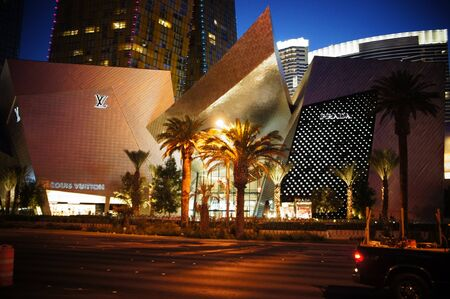 nightime: Las Vegas, Nevada - September 2, 2011: The luxurious Louis Vuitton and Prada Shops on the famous Las Vegas Strip, Las Vegas, Nevada  Editorial