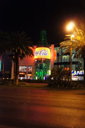 specializes: Las Vegas, Nevada - September 2 2011: Night view of Coca-Cola store that specializes in everything Coca-cola in the Las Vegas Strip in Paradise, Nevada