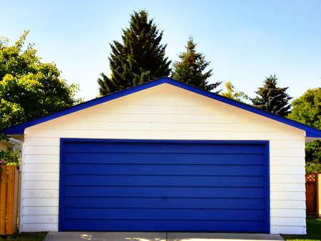 青のガレージのドア 写真素材