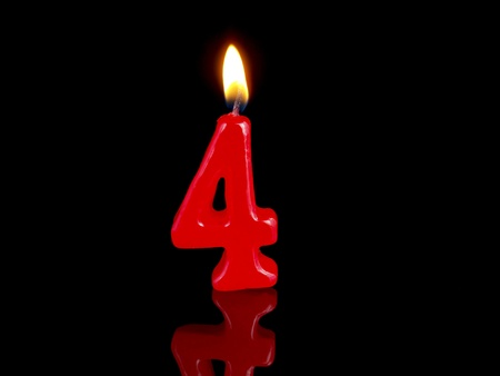 number four: Birthday candle showing Nr. 4
