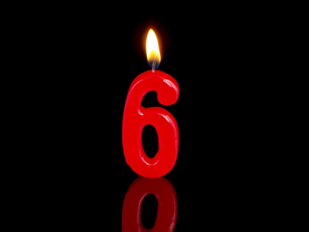 six: Birthday candle showing Nr. 6