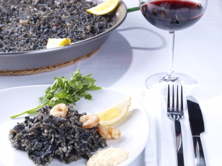 valencian: Arroz Negro Black Rice   Traditional Valencian Dish