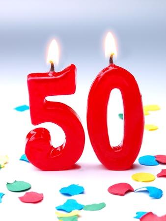 number 50: Velas de cumplea�os que muestran Nr 50 Foto de archivo