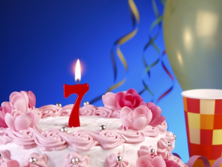 Birthday cake with red candles showing Nr. 7 Stock Photo - 15566311
