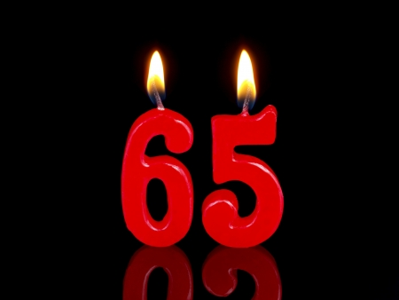 Birthday candle showing Nr. 65 版權商用圖片