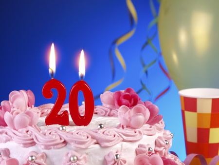 Birthday cake with red candles showing Nr. 20 photo