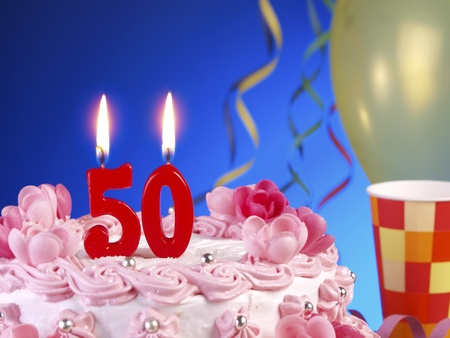 number 50: Birthday cake with red candles showing Nr. 50 Stock Photo