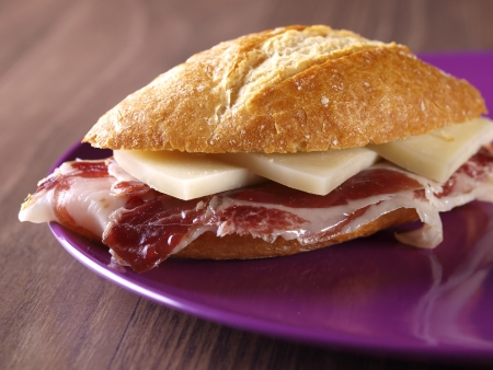 cured: Cured ham and cheese Sandwich  Typical spanish sandwich made with cured ham, cheese and baguette bread