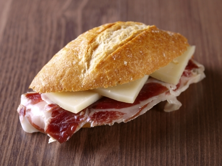 Cured ham and cheese Sandwich  Typical spanish sandwich made with cured ham, cheese and baguette bread
