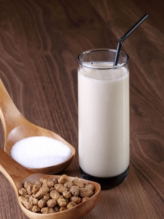 "accompanied: Horchata is a drink, made with the juice of tiger nuts and sugar   Native from Valencia – Spain, it is a refreshing drink, often accompanied with long thin buns called ""fartons""  Stock Photo"