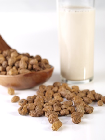 """Horchata is a drink, made with the juice of tiger nuts and sugar   Native from Valencia – Spain, it is a refreshing drink, often accompanied with long thin buns called """"fartons""""  Stock Photo"""