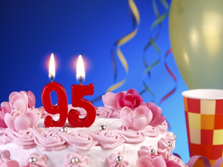 95: Birthday cake with red candles showing Nr. 95