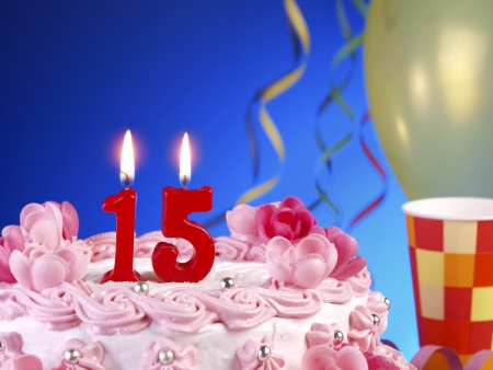 number 15: Birthday cake with red candles showing Nr. 15