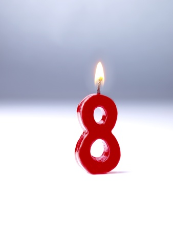 number 8: Birthday candles showing No. 8 Stock Photo