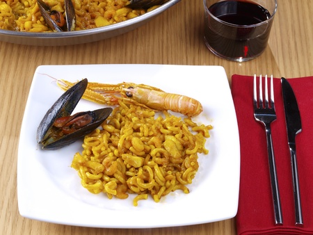 The Fideua is a kind of seafood paella, but replacing the rice per a kind of thick short noodles. photo