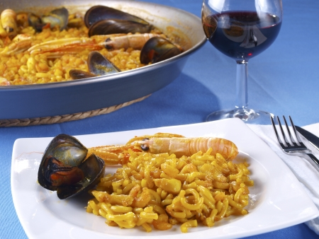 The Fideua is a kind of seafood paella, but replacing the rice per a kind of thick short noodles. Stock Photo