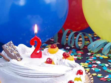 Birthday cake with red candles showing Nr. 2 photo