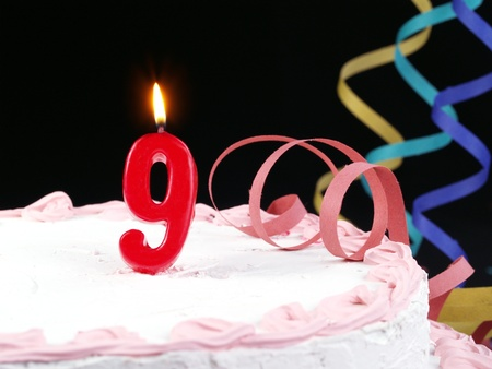 Birthday cake with red candles showing Nr. 9 photo