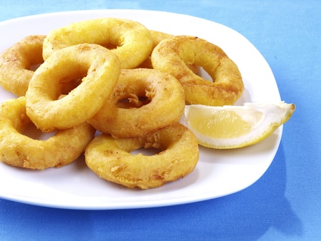 calamares: Spanish Tapa. Tapas are typical spanish appetizer. One of them is: Calamares a la romana,  batter-coated squid rings deep fried, and served with lemon on the side, or  as a sandwich.