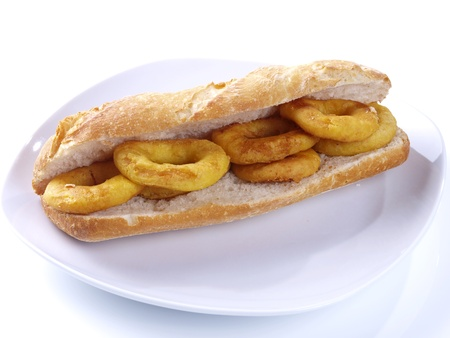Spanish Tapa. Tapas are typical spanish appetizer. One of them is: Calamares a la romana,  batter-coated squid rings deep fried, and served with lemon on the side, or  as a sandwich.