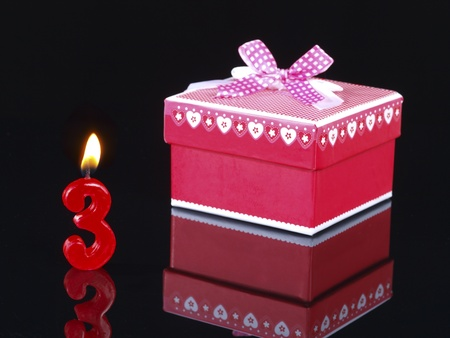 Birthday-anniversary gift with red candles showing Nr. 3 photo