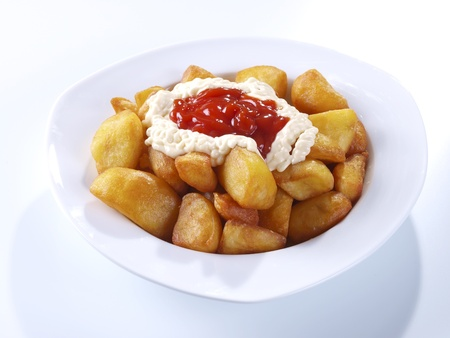 Patatas Bravas,  Fried potatoes served with mayonnaise and a hot spicy sauce  Spanish Tapa  Tapas are typical spanish appetizer