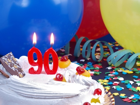 90: Birthday cake with red candles showing Nr  90 Stock Photo
