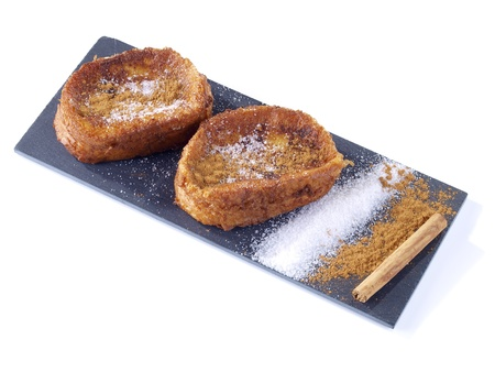 Torrijas are the spanish version of French Toast. Slices of Bread soaked in milk,  egg-coated and fried. Served with sugar and cinnamon. Typical dessert in Easter Season.