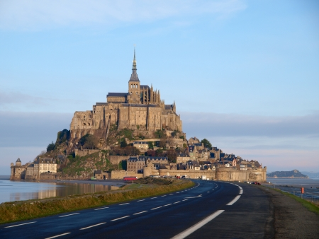 General view of Mont Saint Michel at dawn, second most visited place in France.