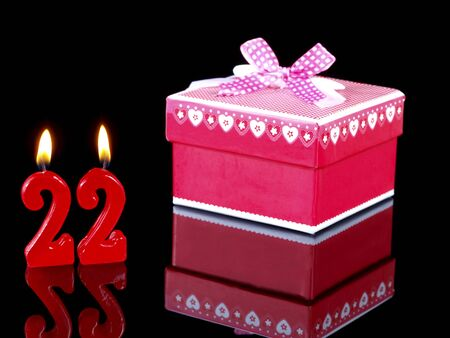 Birthday-anniversary gift with red candles showing Nr. 22 photo