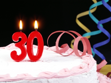 Birthday cake with red candles showing Nr  30 photo